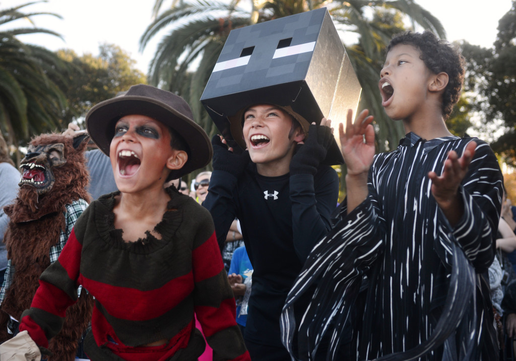 From left to right, Jack Jefferson, dressed as Freddy Krueger, James Jefferson, as a Minecraft character, and Terrell Simmons, as Scream, applaud during the Suisun City Halloween costume contest Thursday. (Robinson Kuntz/Daily Republic)