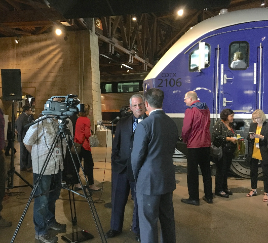 David Kutrsosky answers questions from the press after the locomotive unveiling.