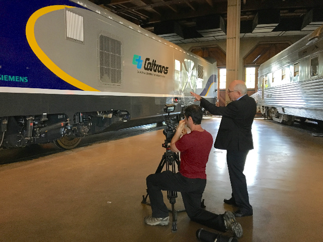 Dave Ward of Siemens directs our cameraman taking videos of the new locomotive.